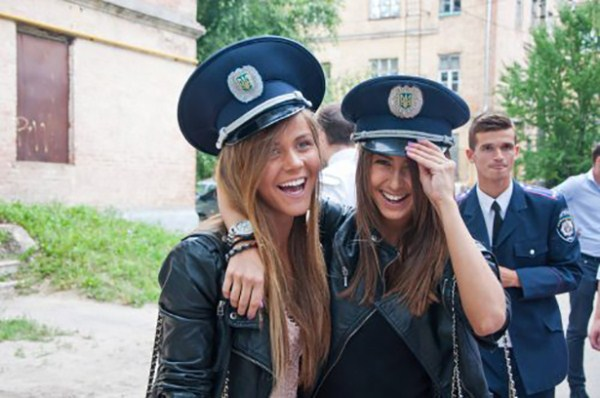 Russian girls taking pictures in police hat