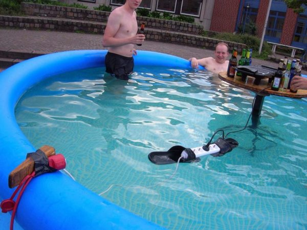 pool party with electric wires in water