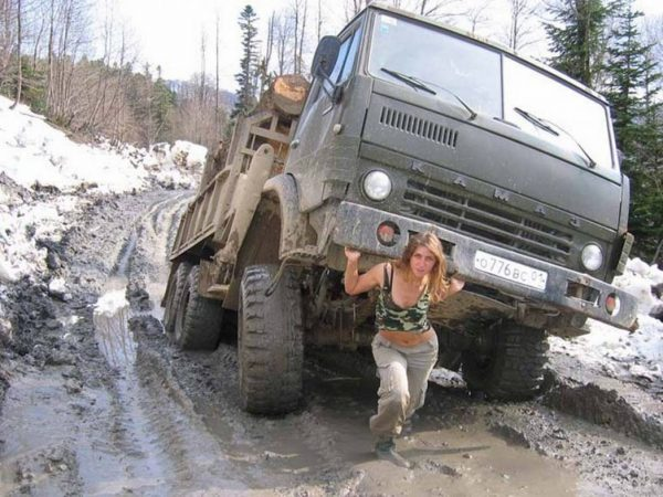 russian woman lifting a truck