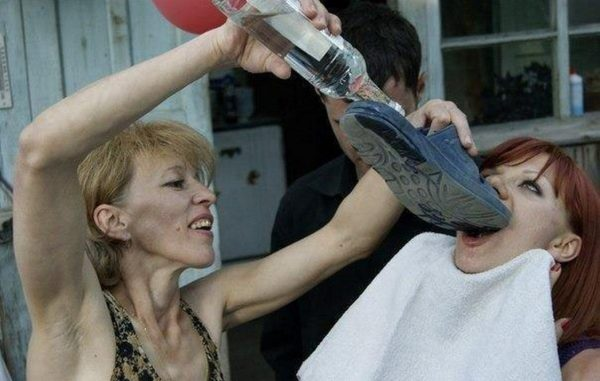 russian women drinking alcohol using shoes as funnel