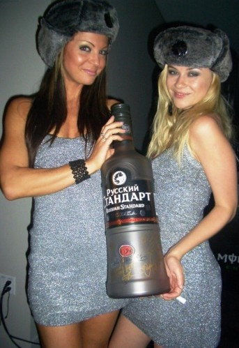 russian women with huge vodka bottle