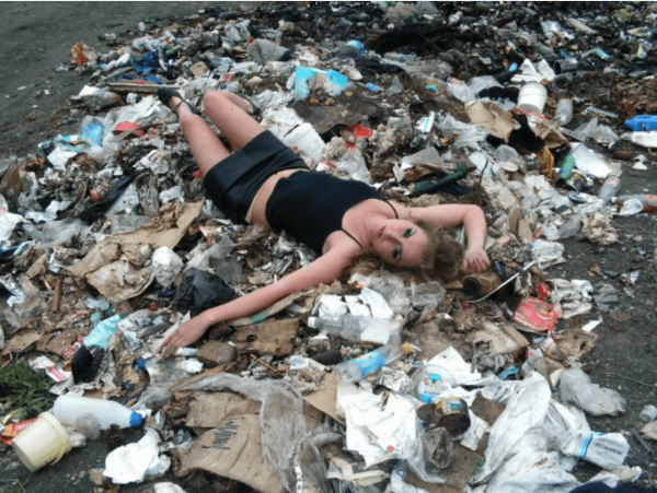 woman laying on trash