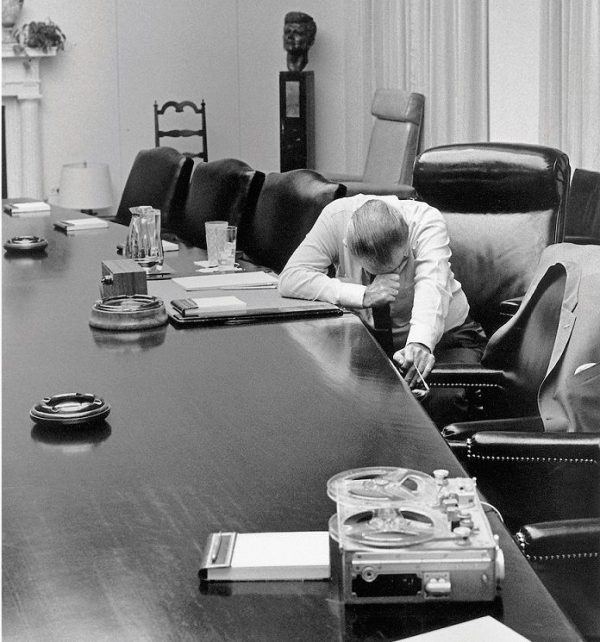 President Lyndon listening to a tape of his son-in-law Capt. Charles Robb