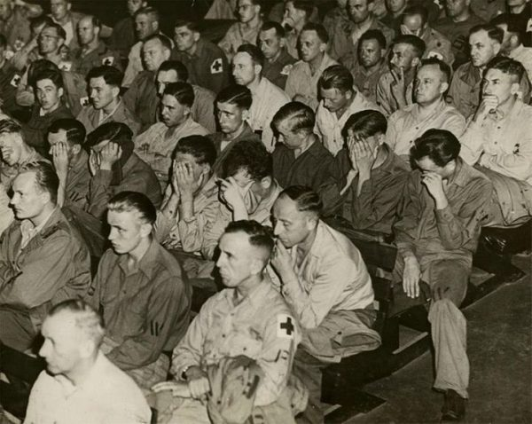 germain pows looking at footage in American prison in 1945